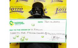 Lottery multimillion dollar winner dresses up as Darth Vader to collect prize