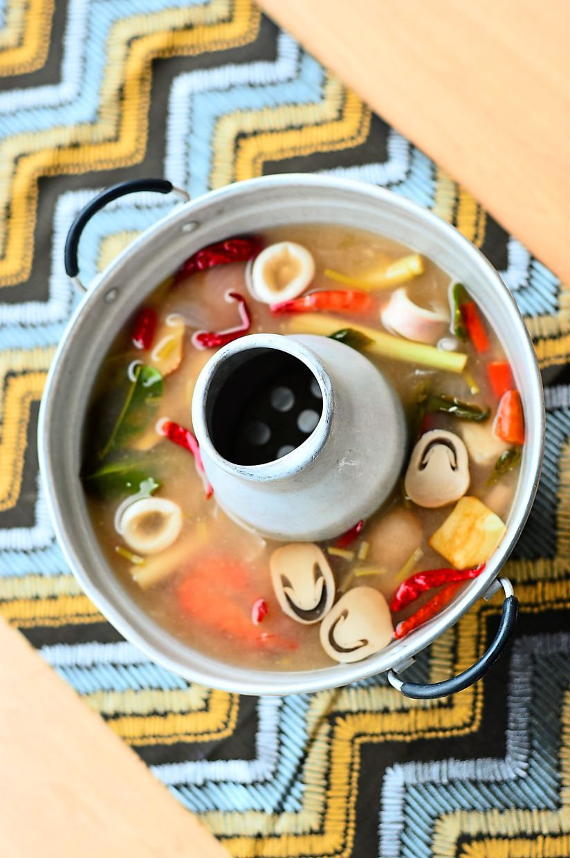 Clear Tom Yam Seafood is not as hot as what you would get in Thailand but has the right balance of flavours.