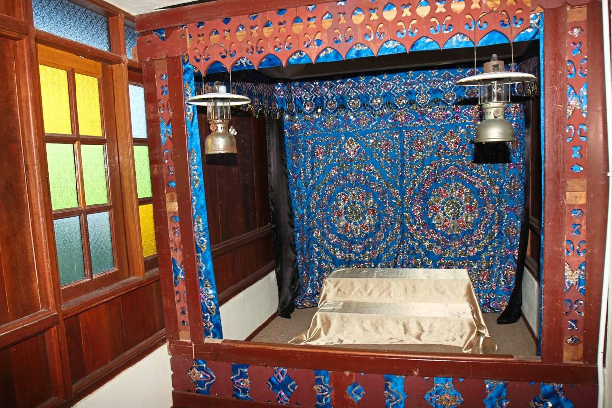 A traditional dais used for Bugis wedding ceremonies on show at the museum. — Filepic