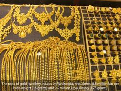 Laotians sell jewellery to take profit as gold prices surge