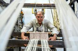 With silkworms long gone, a Syrian turns his home workshop into a silk museum