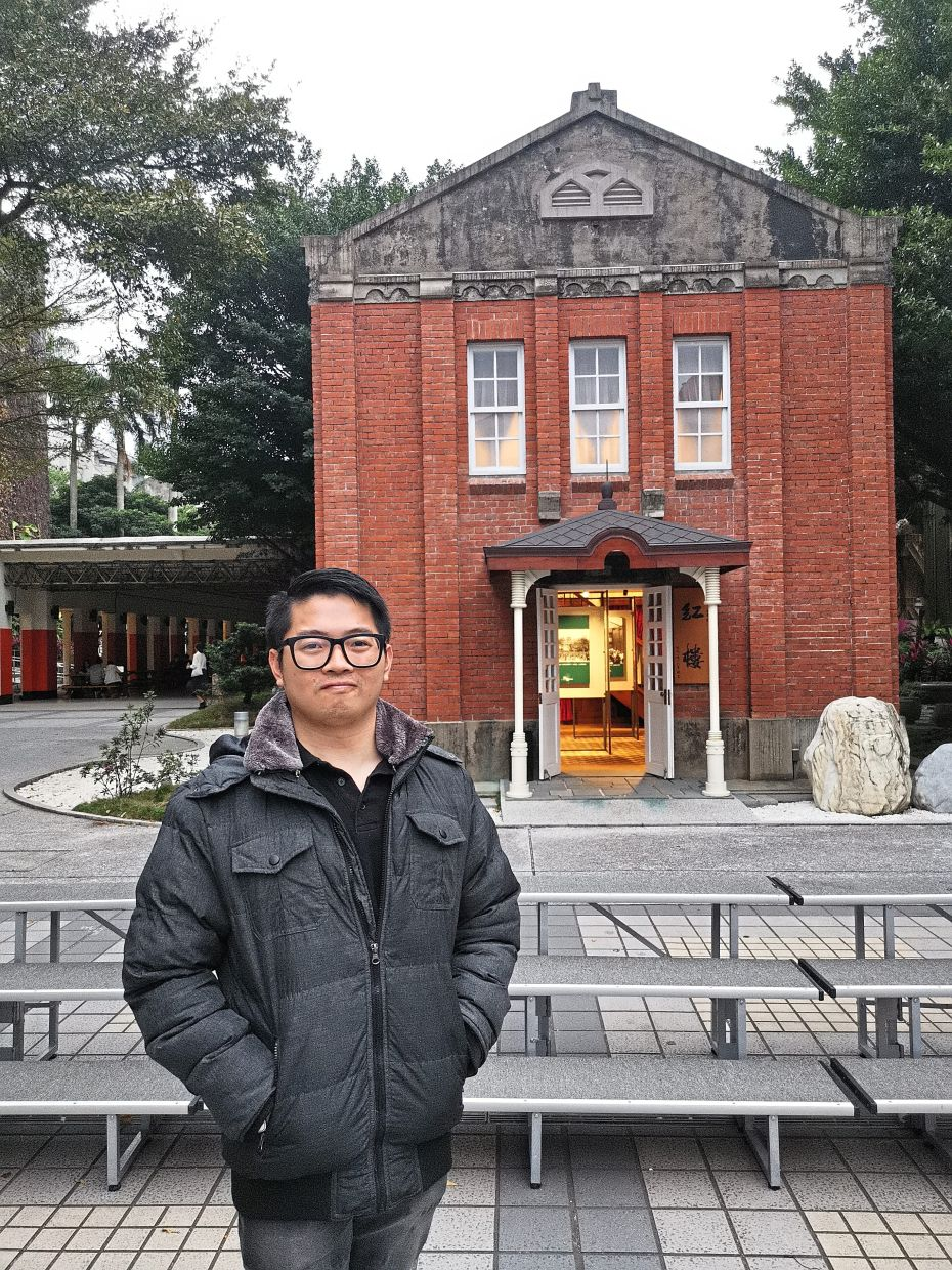Dr Lim in front of Red House, an iconic monument in NTUT.