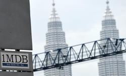 Malaysian ex-PM Najib to learn fate in first 1MDB trial