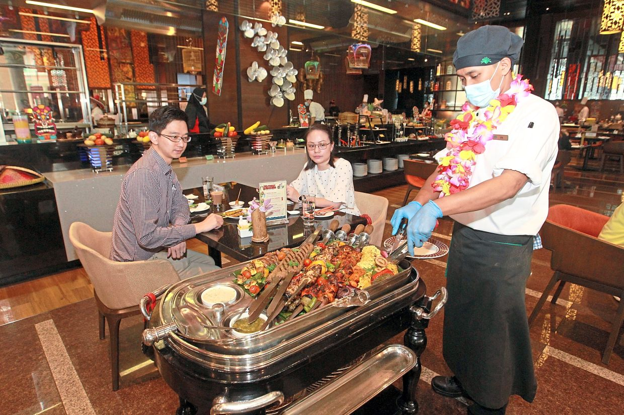 A food trolley featuring grilled meats such as satay, Turkish kebab, Balinese satay lilit and churrasco at Sunway Resort Hotel and Spa.