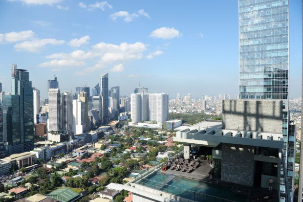 This photo taken on January 29, 2019 shows a general view of the skyline of the financial district of Makati in Manila. (Photo by Ted ALJIBE / AFP)