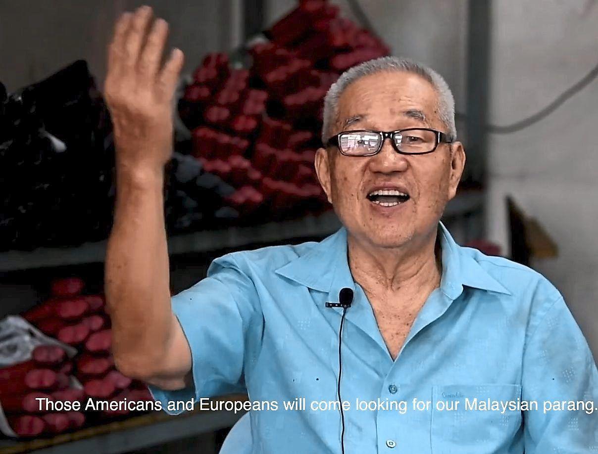 A video screen grab of Chin, a metalsmith from Bidor, Perak, who has been in the business for over 40 years.