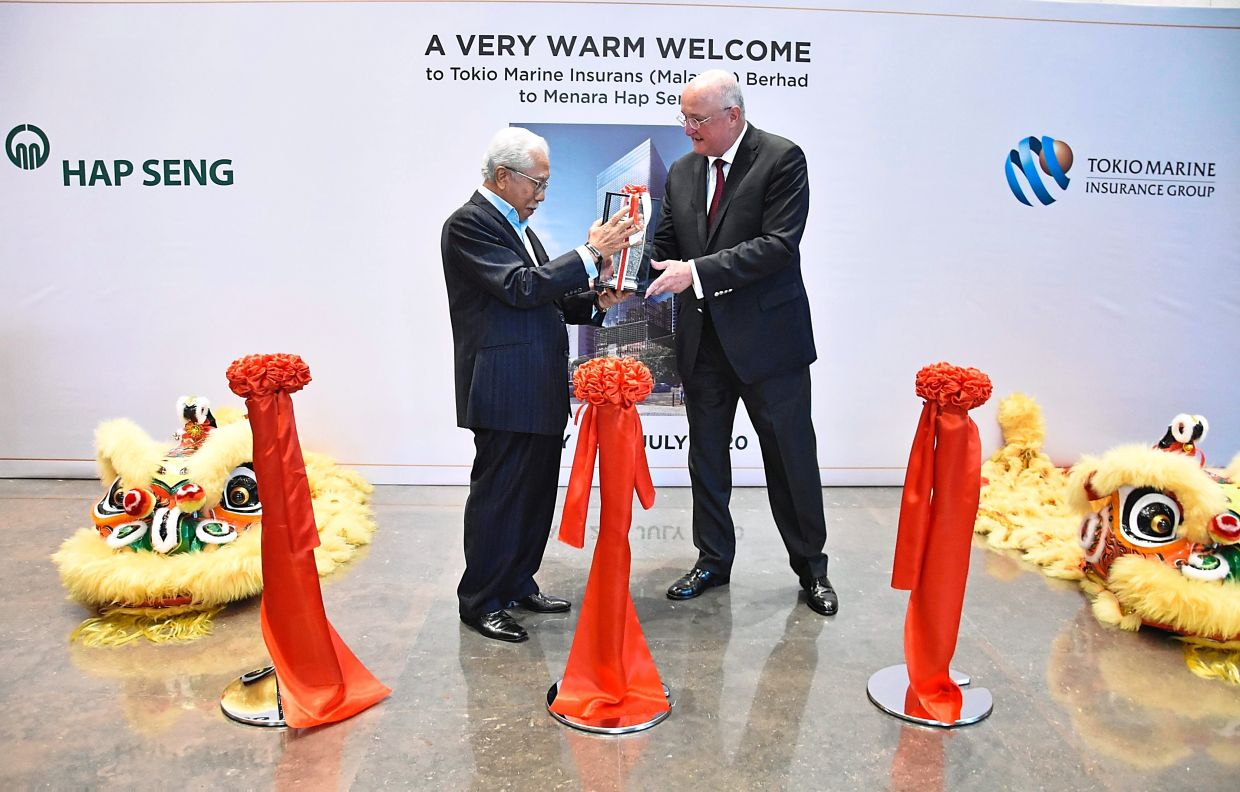 Warm welcome: Tokio Marine Insurans (M) Bhd chairman Datuk Zainal Abidin Putih (left) being welcomed by Hap Seng Consolidated Bhd chairman Thomas Karl Rapp. Tokio Marine is the anchor tenant at the newly completed Menara Hap Seng 3, which is part of the Plaza Hap Seng in Kuala Lumpur.