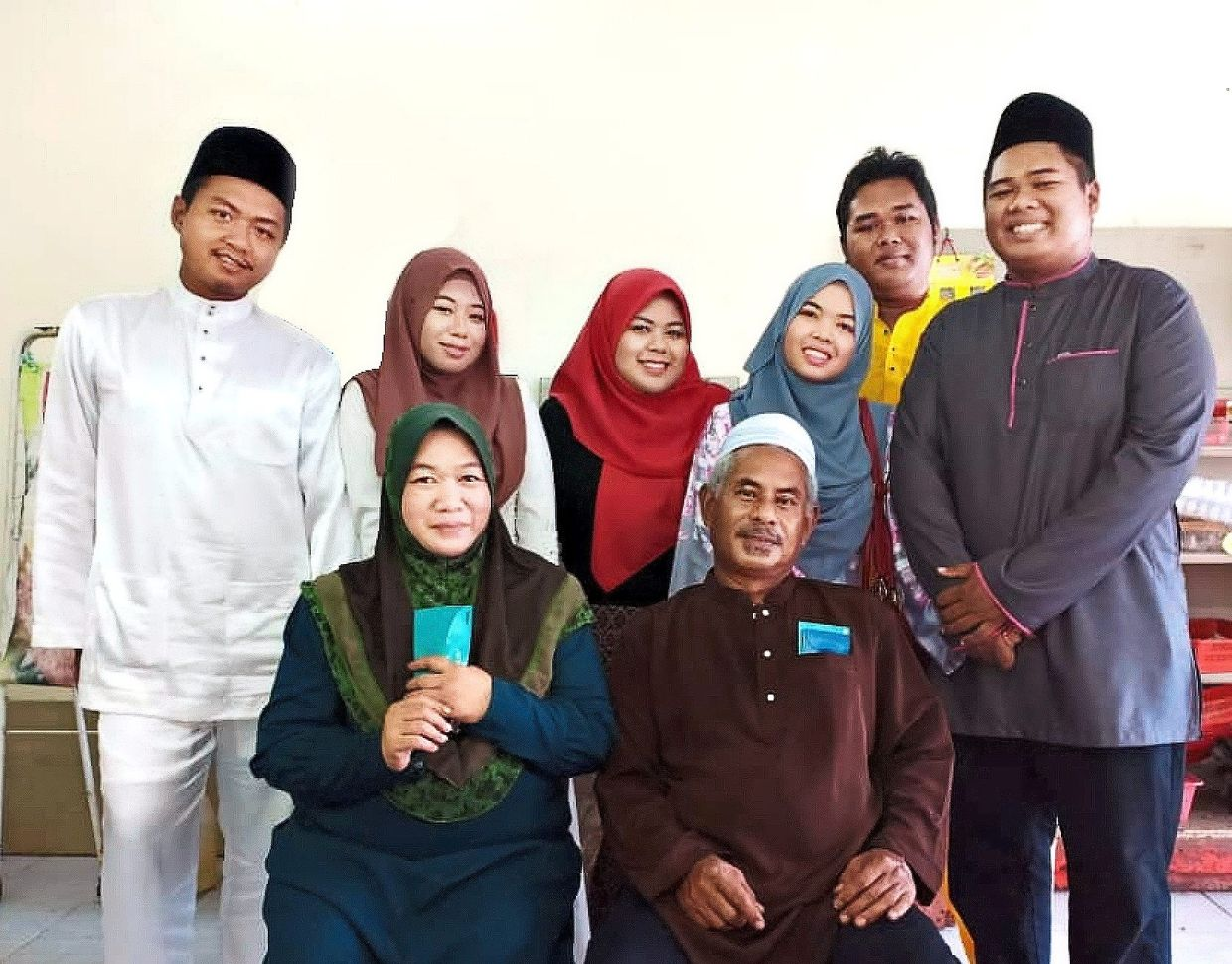 Ain Nadjwa (in red) with her family during Hari Raya in Pekan last year. Photo: Ain Nadjwa Idzwanna Akasah