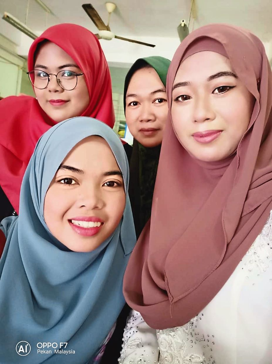 (clockwise from top left) Ain, her mother, her sister and her sister-in-law in their hometown Pekan. Photo: Ain Nadjwa Idzwanna Akasah