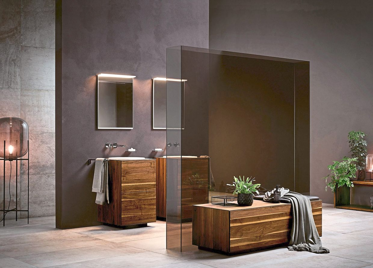 It might feel like a risk – and it is one – but bathrooms in mostly dark tones can look classy if done well.