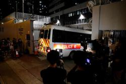Hong Kong police arrest four under new security law