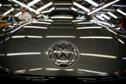 VW cuts dividend as H1 profits plunge on pandemic sales drop