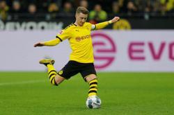 Dortmund captain Reus still injured, to miss pre-season start