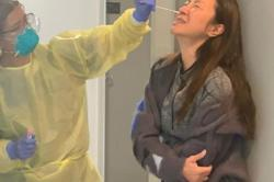 Michelle Yeoh grimaces in pain during Covid-19 swab test