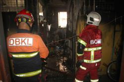 Senior citizens escape burning apartment block in KL
