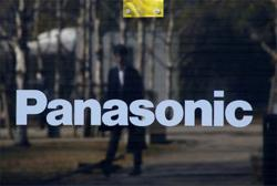Panasonic expects annual profit to halve