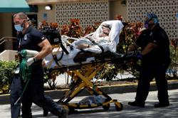 California, Florida report record increases in COVID-19 deaths