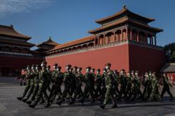 China's central bank to issue Forbidden City commemorative coins on 600th anniversary