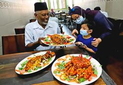 Nasi kandar with luxury on the side