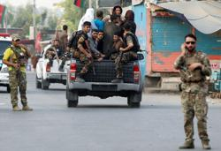 Afghan forces besiege prison seized by Islamic State fighters
