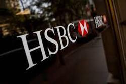 HSBC 1H profit falls 65% on loan provisions