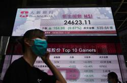 Asian markets track Wall St surge, focus turns to Capitol Hill
