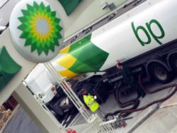 BP cuts dividend after record loss in Q2