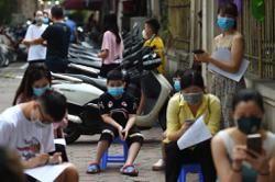 Vietnam capital low on kits for mass tests as nation's virus cases climb