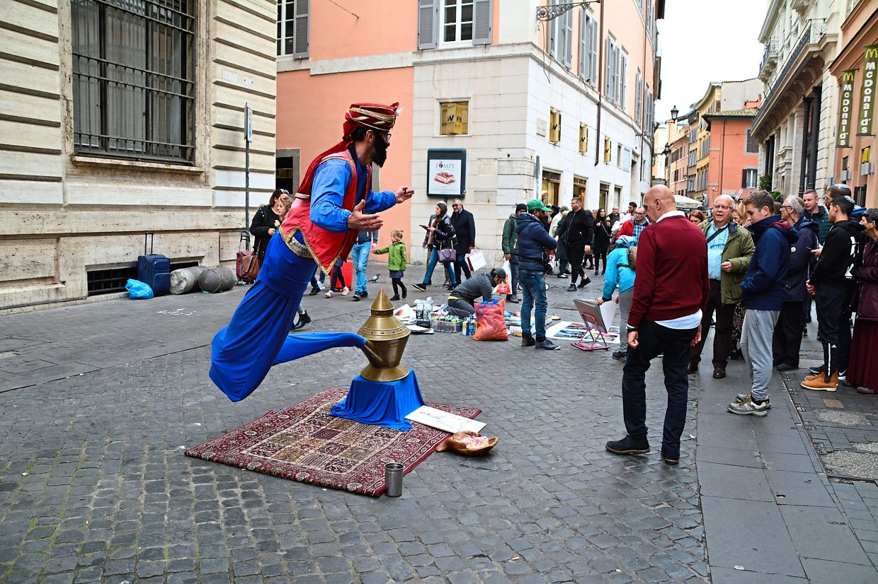 You can find lots of interesting street performers, like this genie, in Rome.