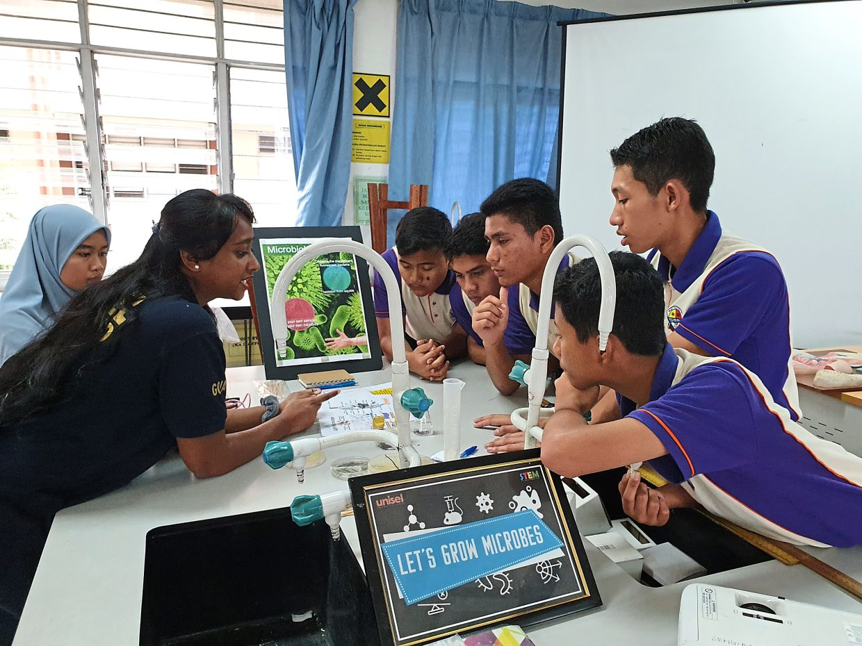 A photo from January this year of Unisel STEM Squad members (left) explaining one of its modules to students. The project received grant from PJ SEED. — Photo courtesy of Unisel