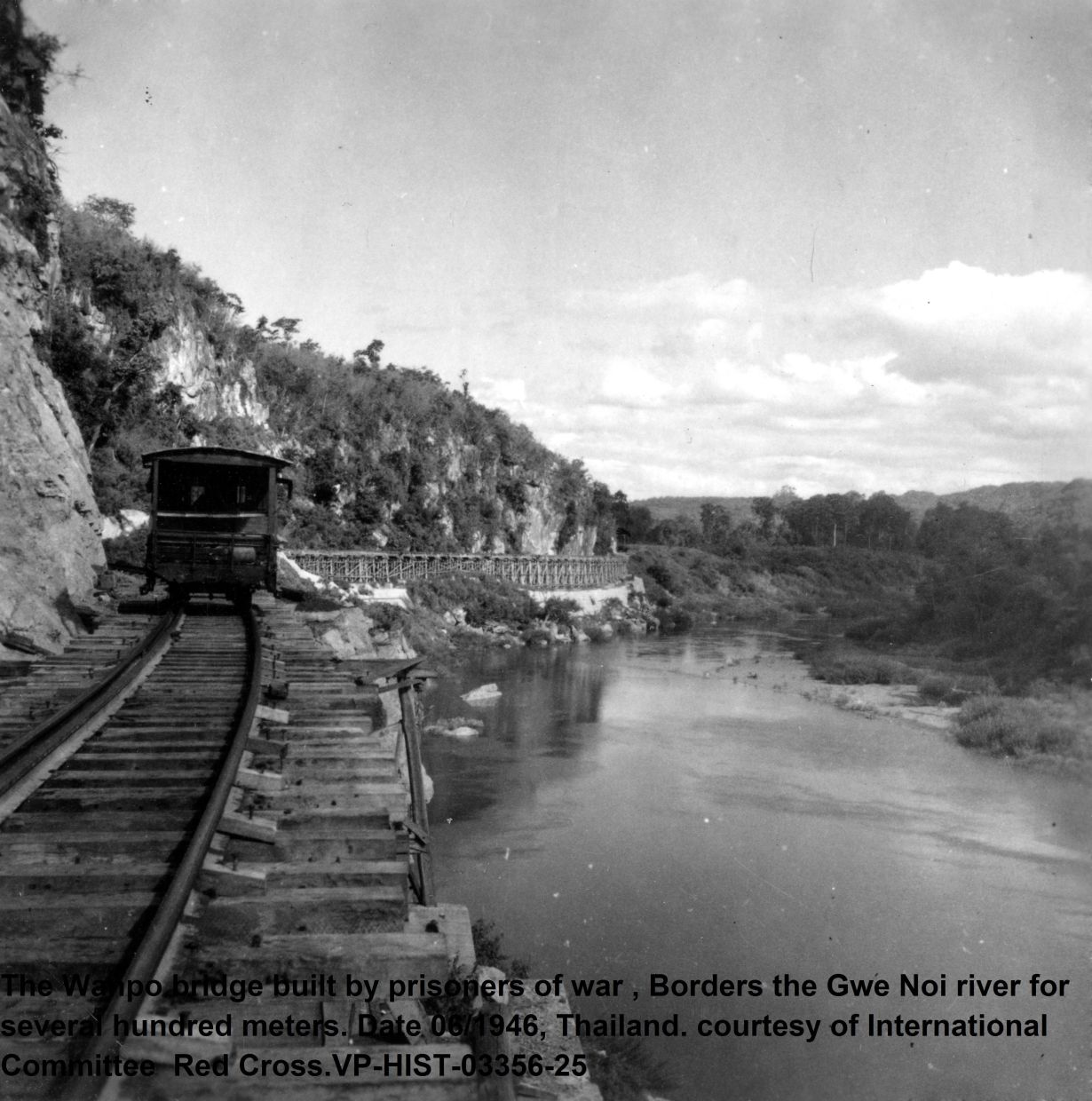 The Wanpo bridge, built by prisoners of war, borders Gwe Noi (Kwai Noi) river for several hundred metres. Picture taken in June 1946, Thailand. Photo: International Red Cross