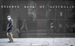 Australia central bank sees bumpy road to recovery