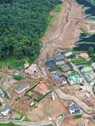At least 13 killed in landslides