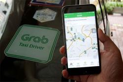 Grab to expand finance business in Singapore, Malaysia