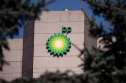 BP halves dividend after record loss, speeds up reinvention