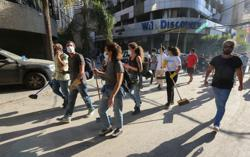 Dazed and wounded, Lebanese emerge from massive blast angry at rulers