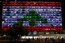 Israeli square bathed in Lebanese colours in rare show of support over Beirut blast