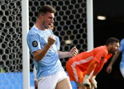 City have unfinished business in the Champions League, says Laporte