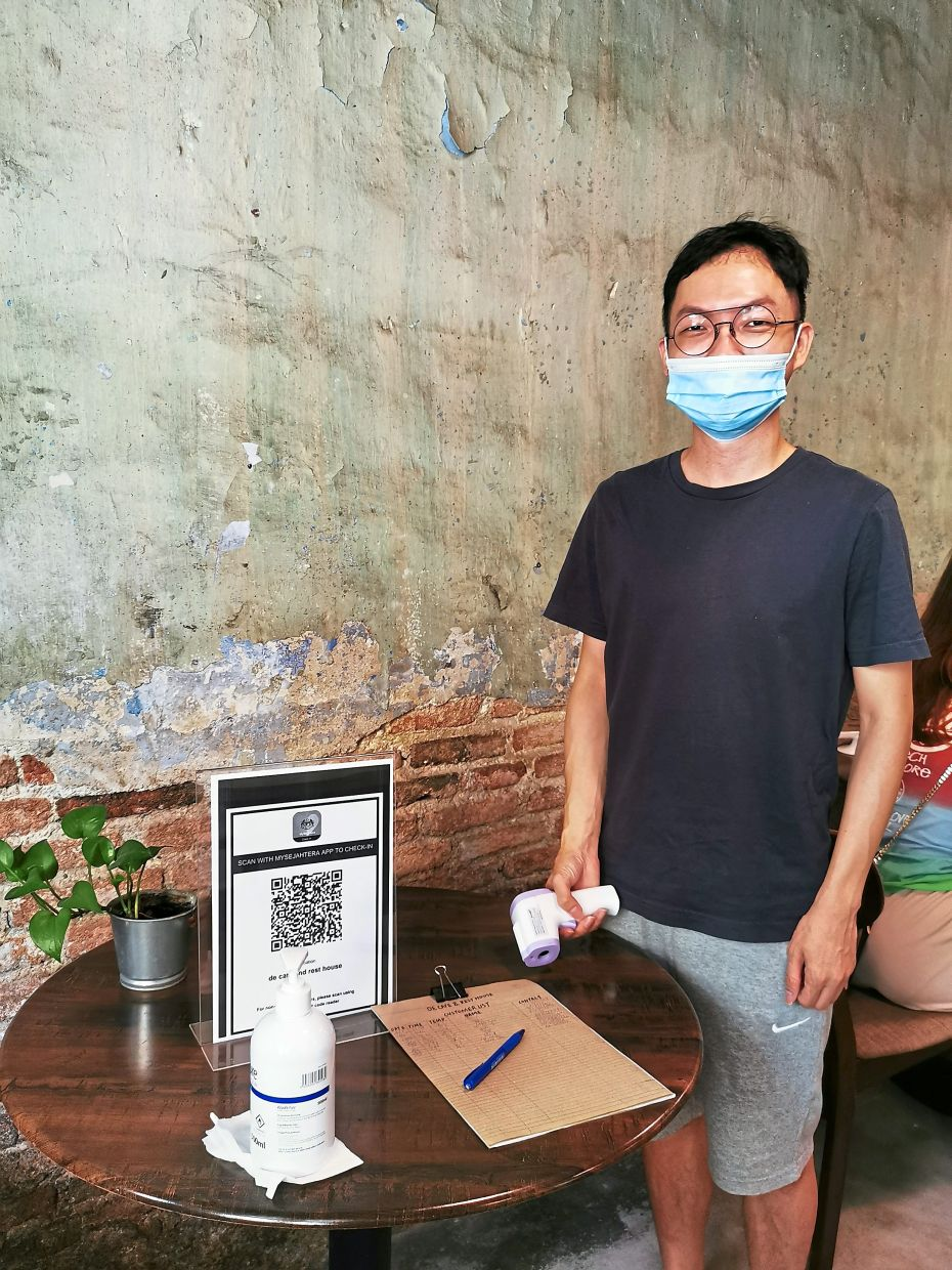 Tham says his staff manually  register customers' contact  details and body temperature.