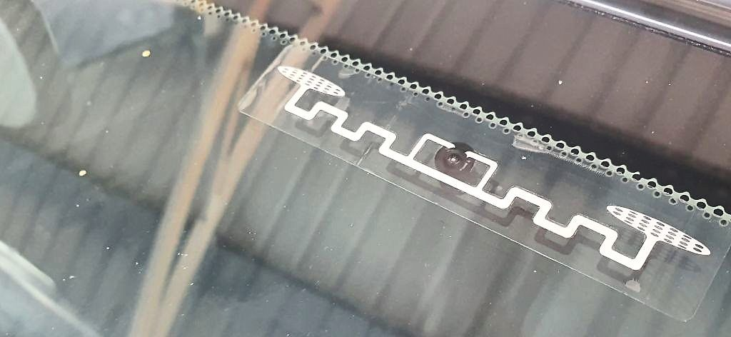 The Touch 'n Go RFID tag embedded on a vehicle.