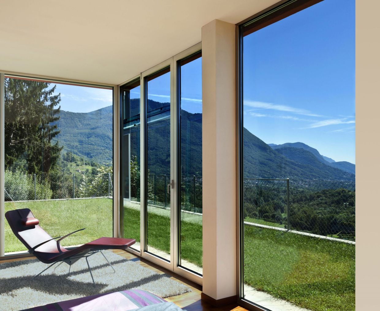 Direct sunlight can make rooms unbearably hot. One possibility: Glass that can darken in sunlight.