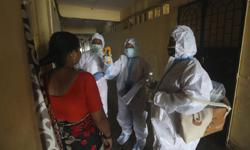 India hits 2 million cases as health volunteers strike