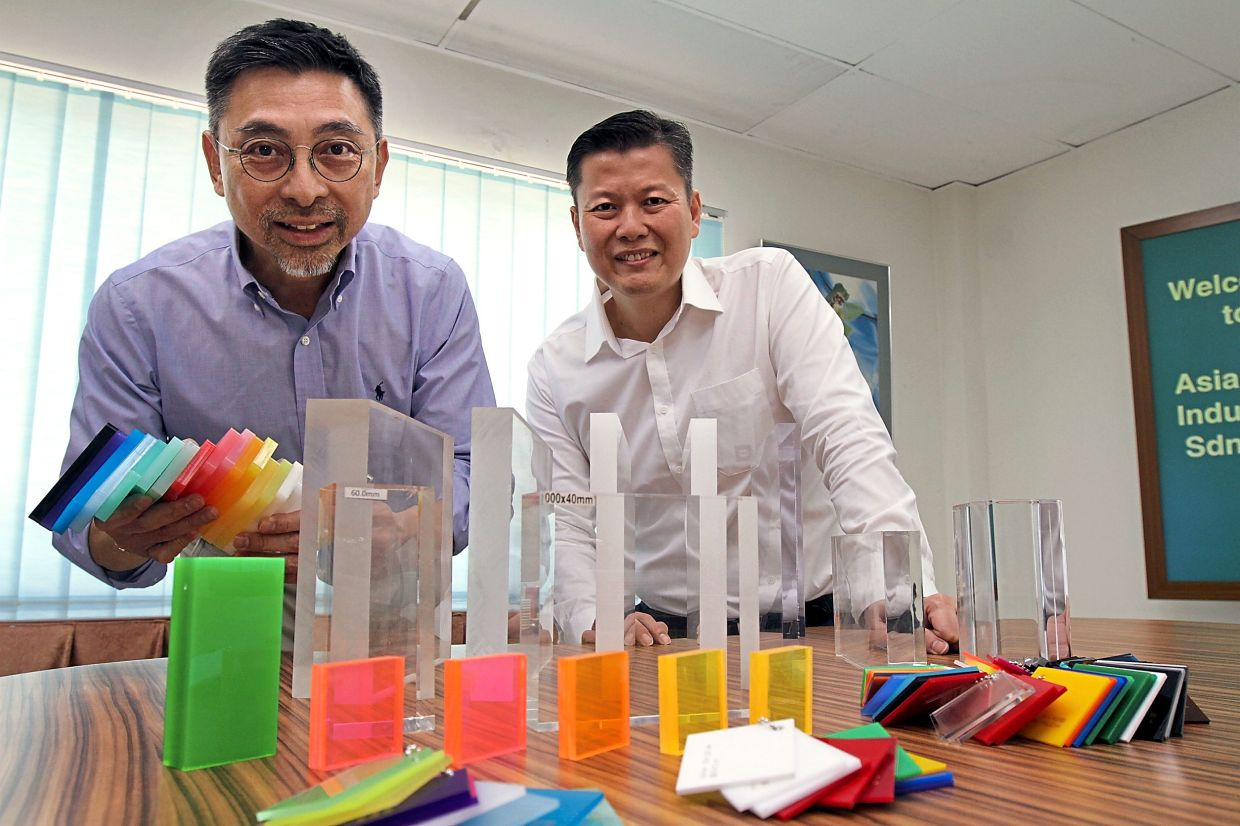 Niche player: Yeo (left) and Asia Poly director Bernard Tan with samples of the company's products. Asia Poly is the only listed Malaysian manufacturer of cast acrylic sheets.