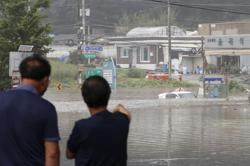 Landslide from heavy rain kills four in South Korea