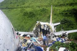 India's plane mishap death toll rises to 18, bigger tragedy averted