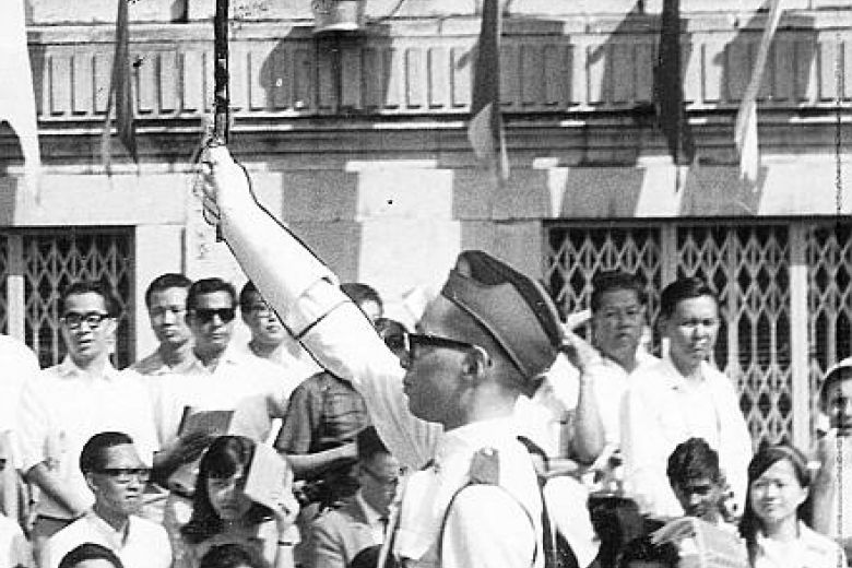 PM Lee, as a student in Catholic High School, leading the combined reed and brass band in the National Day Parade in 1968. - The Straits Times/Asian News Network