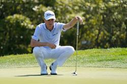 Golf: Thomas watches solid round get blown away in the wind