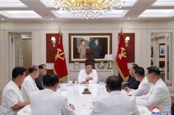 North Korea's Kim sends aid to city locked down over virus
