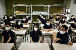 Vietnamese high school students take national exam amid strict virus control measures