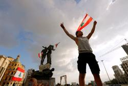 Beirut police fire tear gas as protesters regroup and two ministers quit